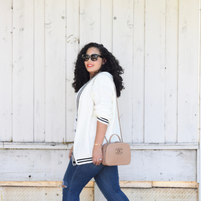 Tanesha Awasthi, also known as Girl With Curves, wearing a preppy cardigan, jeans and Chanel bag.