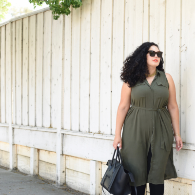 Tanesha Awasthi, also known as Girl With Curves, wearing a plus size shirtdress, leggings, Celine phantom, Celine sunglasses and orange lipstick.
