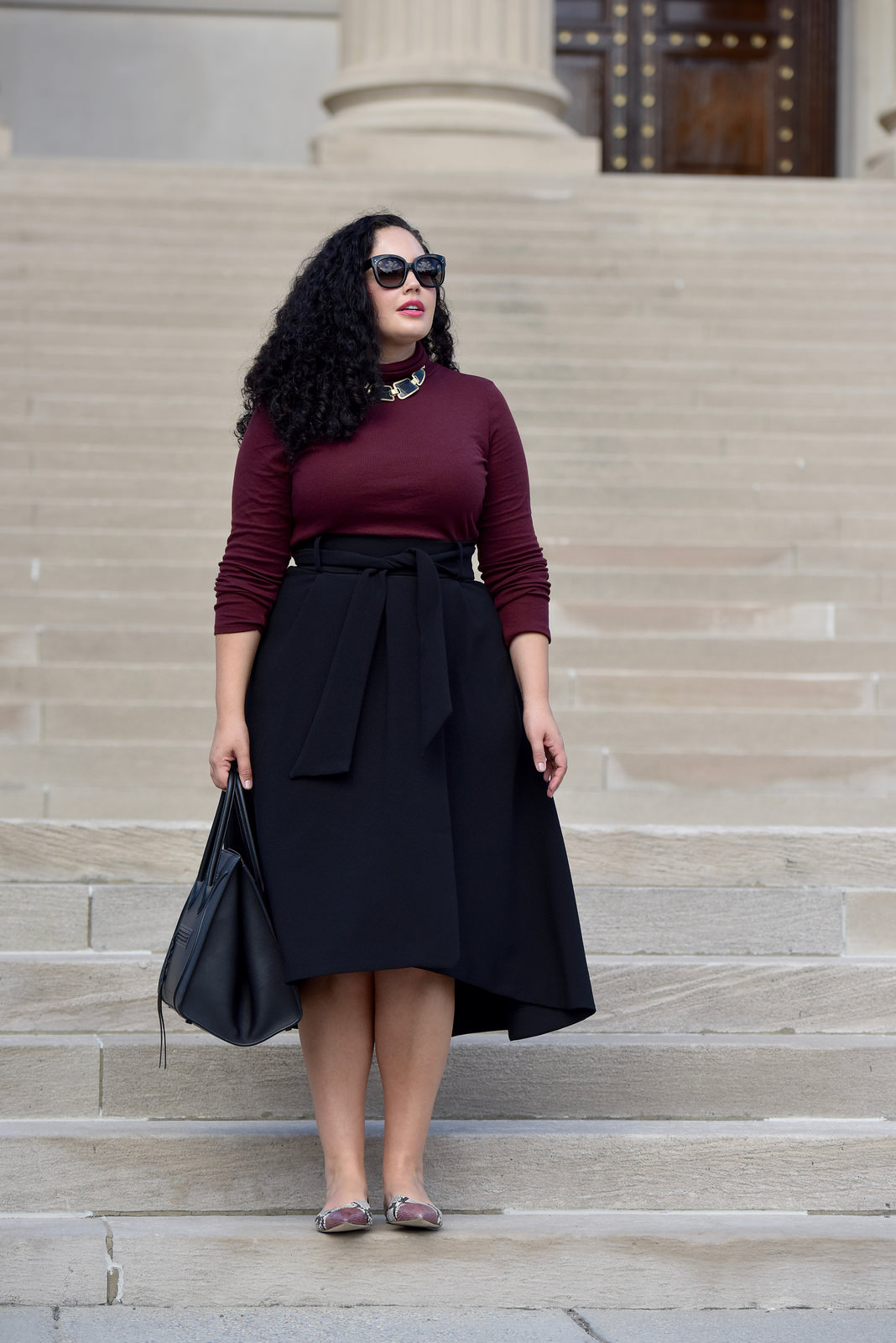 Burgundy Turtleneck, Waist Tie Midi Skirt, Snake print flats and Celine Phantom worn by Tanesha Awasthi, founder of Girl With Curves