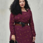Girl With Curves blogger Tanesha Awasthi wears a belted floral midi dress.