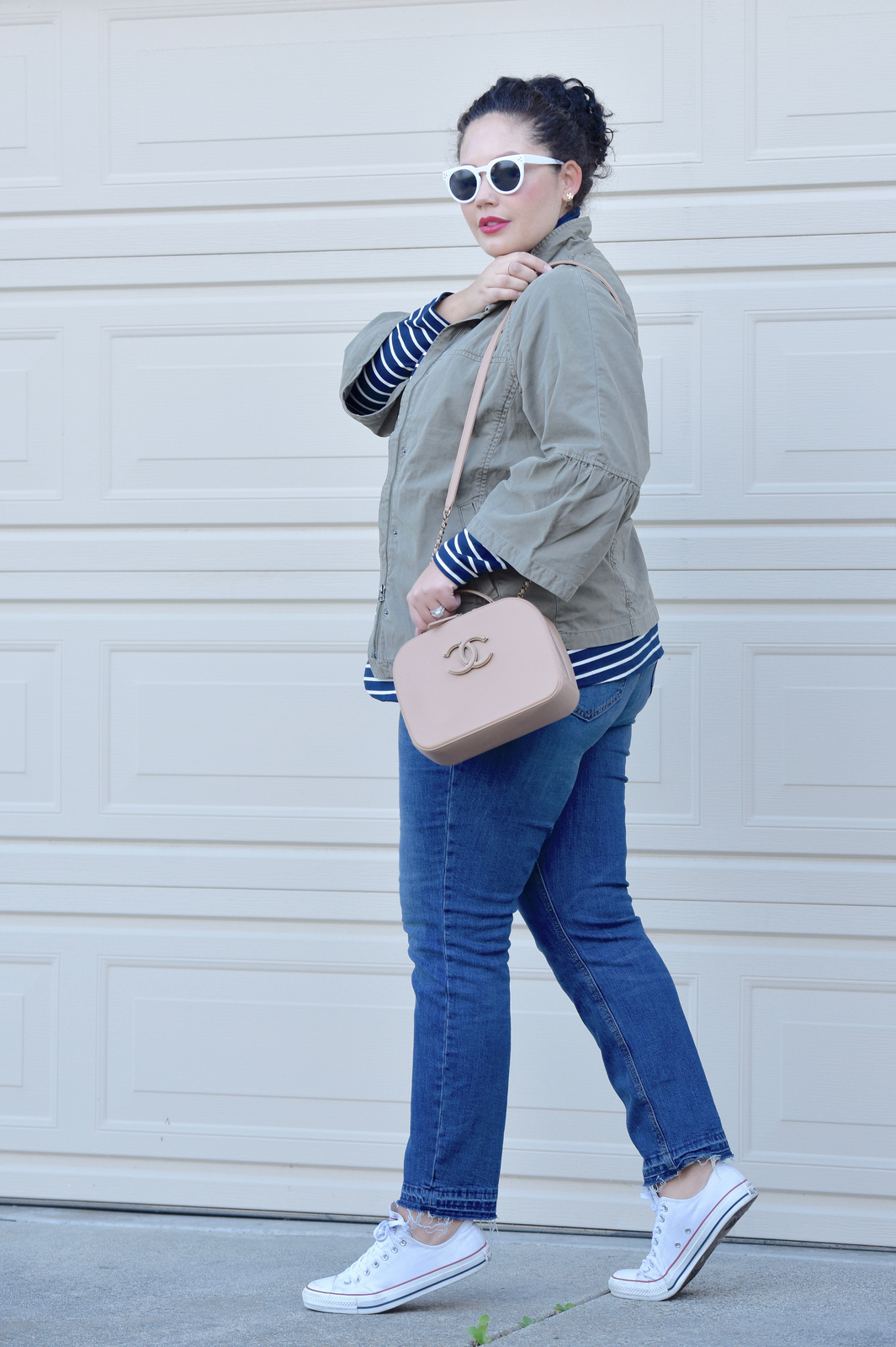 Girl With Curves blogger Tanesha Awasthi wears a utility jacket, boyfriend jeans and converse.