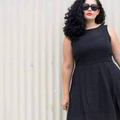 Girl With Curves wearing a gingham black dress from Nordstrom.